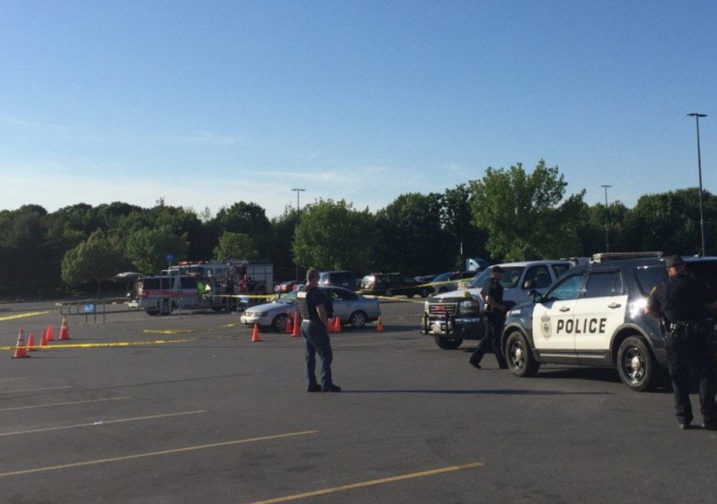 Police gather at the Augusta Wal-Mart parking lot on June 26, 2016, after a dispute over money and drugs led to shots being fired.