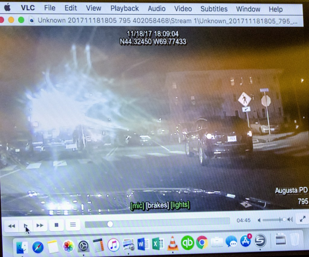 This image comes from video from an Augusta Police Department dashboard camera shown during opening statements Wednesday at Andrew Bilodeau's jury trial at the Capital Judicial Center in Augusta.