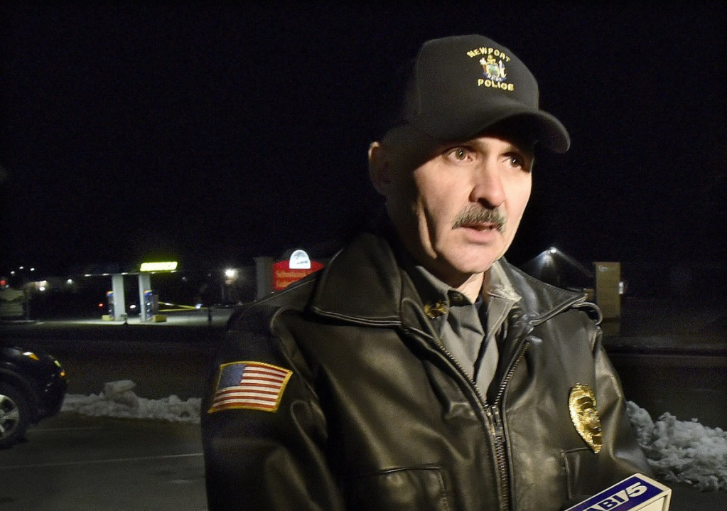 Newport police chief Leonard Macdaid speaks across the street from Bear's One Stop store in Newport after a shooting Wednesday evening.