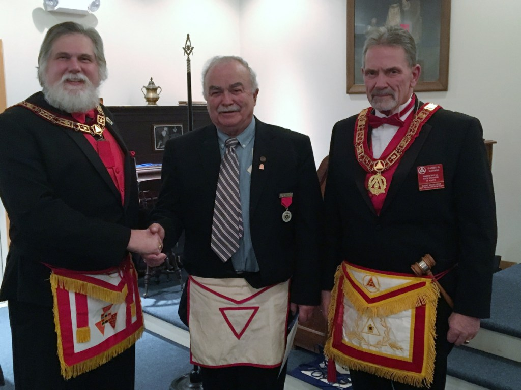 Ronald Emery, of China, center, received his 50 Year Pin at Dunlap Chapter No. 12 at the Stated Meeting held Wednesday evening. Inspection by the Grand Officers was on the Most Excellent Degree with Emery setting in the East. He was presented the 50 year pin by Most Excellent Grand High Priest Brian S. Messing, left, and Right Excellent Daniel Hanson, District Deputy Grand High Priest.