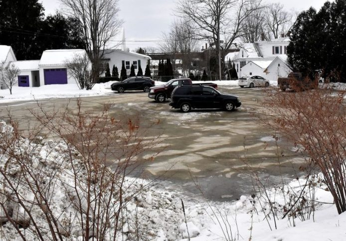 The town of Farmington will lease this parking lot off Anson Street in Farmington to help ease parking problems involving employees at the nearby Origin USA company.