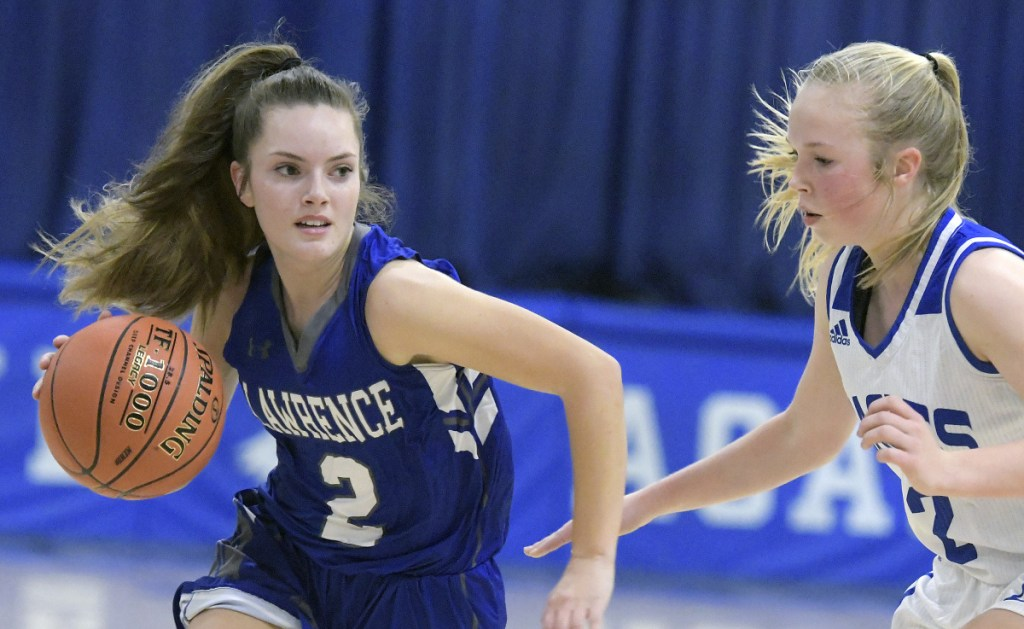 Erskine's Mackenzie Roderick, right, guards Lawrence's Megan Curtis during a Kennebec Valley Athletic Conference game Friday  in South China.