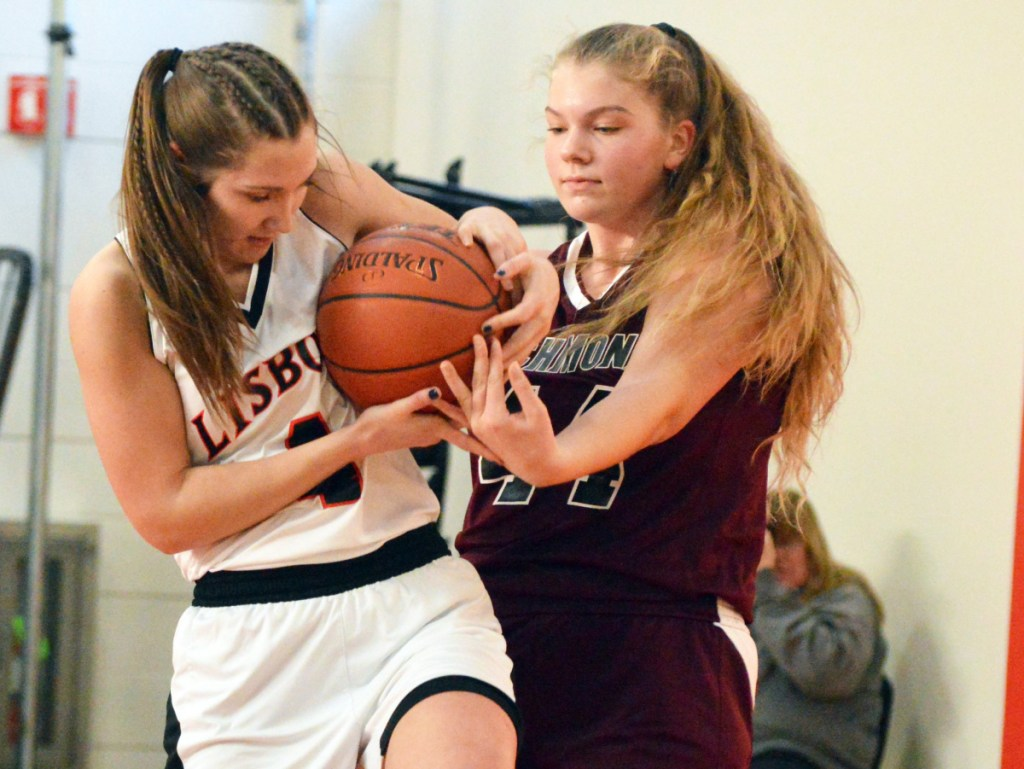 Times Record photo by Bob Conn   Lisbon's Charlee Cox, left, and Richmond's Macy Carver (44) battle for possession during Saturday's MVC game in Lisbon.