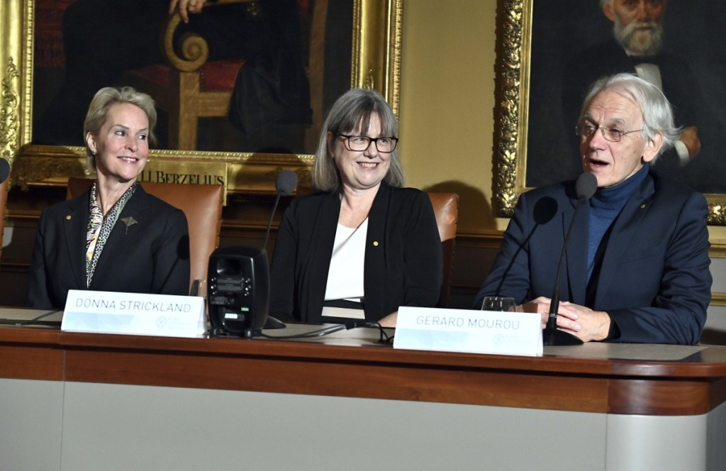 Frances H. Arnold, 2018 Nobel laureate in Chemistry, left, Professor Donna Strickland, 2018 Nobel laureate in Physics, and Professor Gerard Mourou, 2018 Nobel laureate in Physics take part in a press conference at the Royal Academy of Science in Stockholm, Sweden, Friday Dec. 7, 2018.