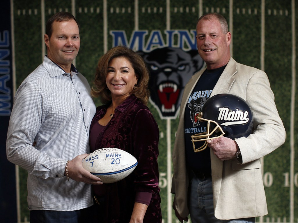 From left, University of Maine fans and alumni Dan Maloney, Class of '85, his wife, Lisa Maloney '86, and Jamie Keefe '86, plan to fly out west this weekend to watch the Black Bears take on Eastern Washington University in Saturday's Football Championship Subdivision semifinal. Back in the day, Maloney was an offensive lineman on the squad; Keefe played linebacker.