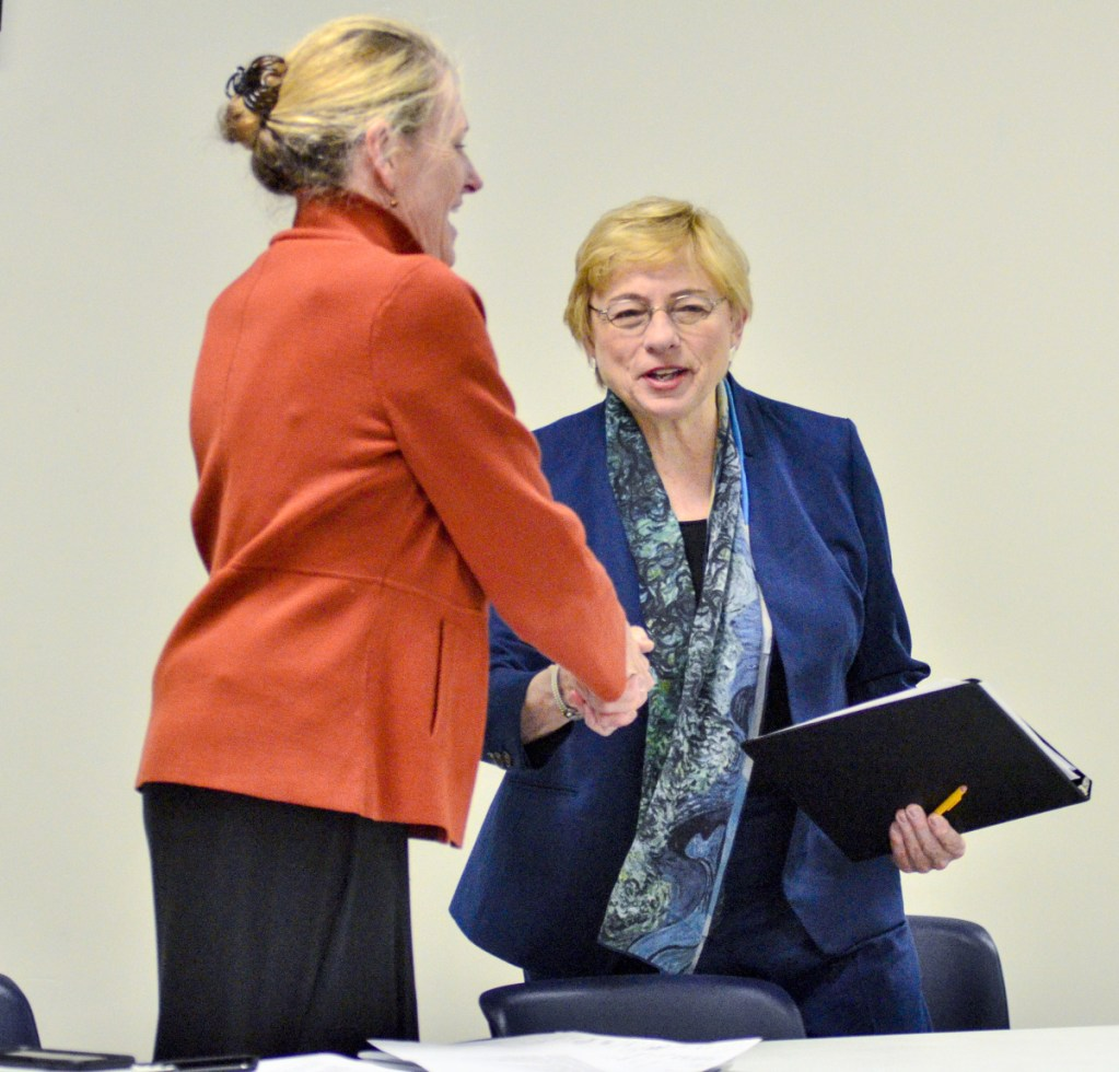 Jeanne Lambrew, the nominee to head the Department of Health and Human Service, left, and Gov. Janet Mills shake hands after Mills spoke at a session of the Medicaid Expansion Stakeholder Roundtable on Thursday at the Ice Vault in Hallowell.