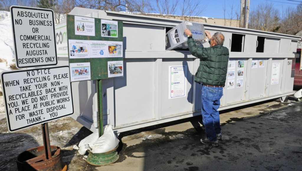 John Nims empties a box of recyclables into a roll-off container in 2015 at the John Charest Public Works Facility in Augusta.