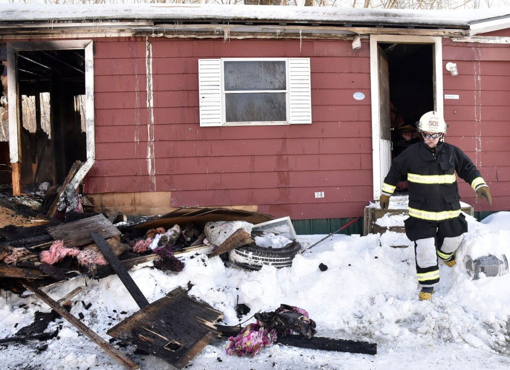 Cornville Deputy Chief Alan Nickerson exits the mobile home at 773 East Ridge Road in Cornville, which was destroyed by fire Tuesday. Nickerson said the homeowners are not insured and the fire was the result of thawing out frozen water pipes. Firefighters from Cornville, Madison and Skowhegan arrived to put the fire out.