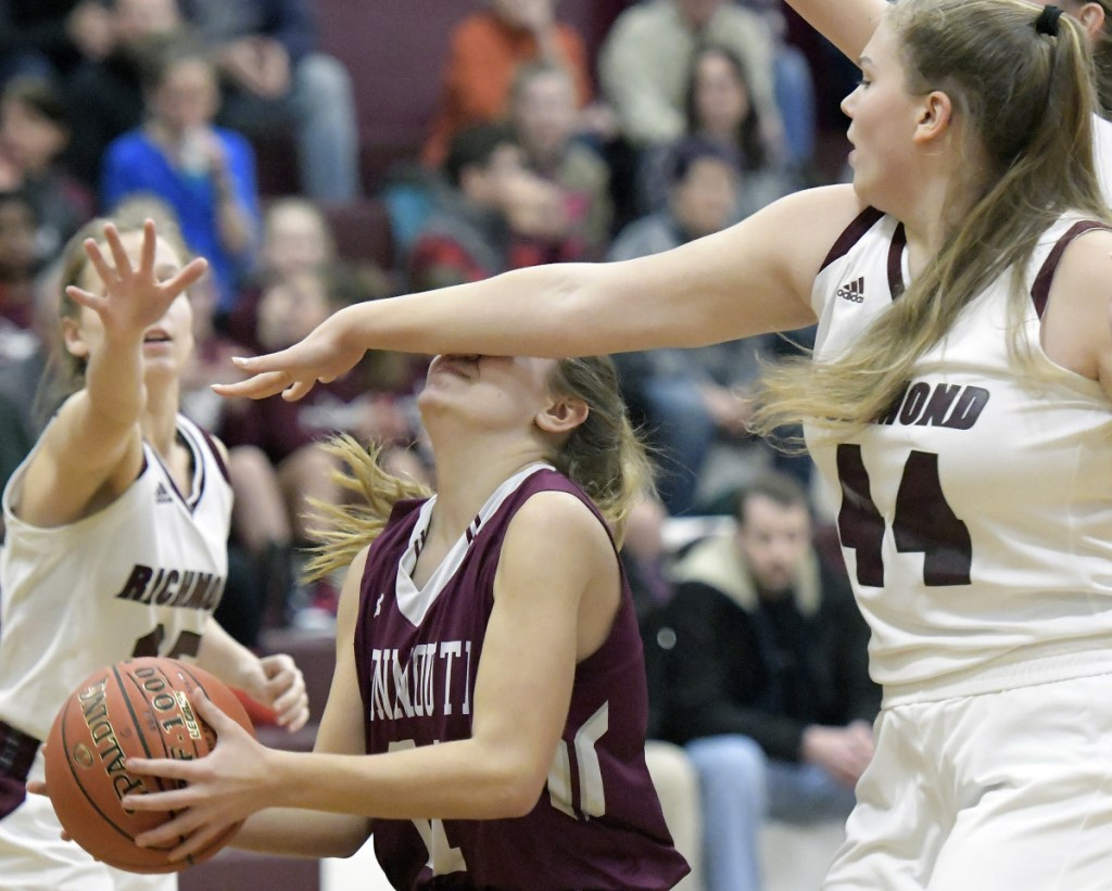 Richmond's Macy Carver (44) defends Monmouth's Abby Ferland during a Mountain Valley Conference game Thursday in Richmond.