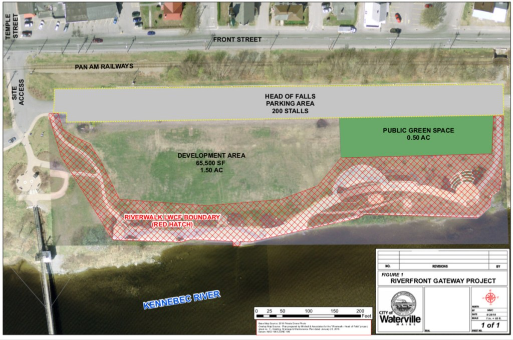 The area Waterville is targeting for development as the Riverfront Gateway Project is between the paved parking lot and the RiverWalk at Head of Falls.