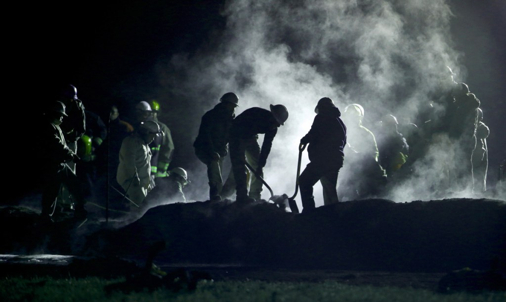 Petroleos Mexicanos staff work the area of a oil pipeline explosion in Tlahuelilpan, Mexico, on Saturday. More than 85 people are listed as missing.