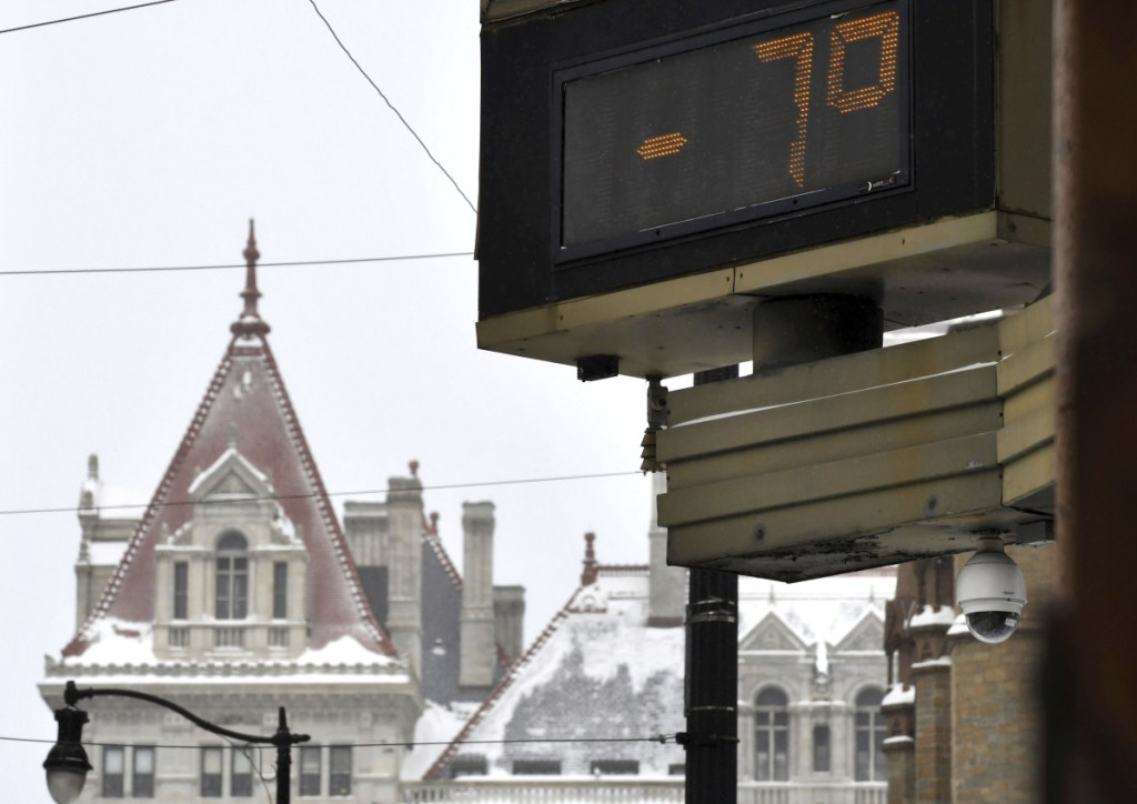 With temperatures 7 below zero in Albany, New York, and winds gusting to 3o mph windchills approached minus 40 degrees in northern New York and Vermont on Monday. The temperature is shown at the Bank of America Financial Center on State Street against a backdrop of the New York State Capitol on Monday in Albany. Maybe more