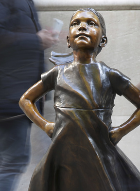 """A lawsuit against """"Fearless Girl"""" artist Kristen Visbal says she breached a contract.  Associated Press/Seth Wenig"""