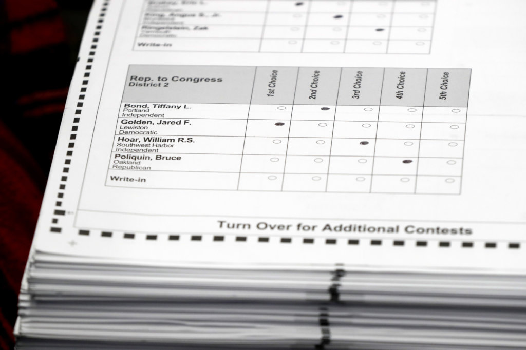 Ballots were prepared for recounting in Maine's 2nd Congressional District, Thursday, Dec. 6, 2018, in Augusta. The recount was requested by outgoing U.S. Rep. Bruce Poliquin after losing a November ranked-choice race to Rep.-elect Jared Golden.