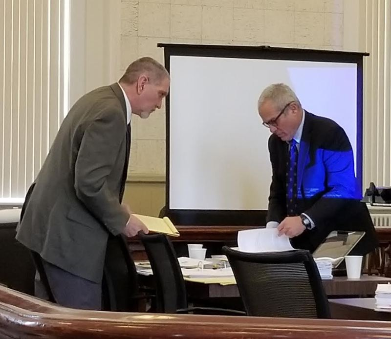 James Sweeney, left, formerly of Jay, and his co-defense lawyer, Walter Hanstein, confer during a break Thursday, the third day of Sweeney's murder trial at Franklin County Superior Court in Farmington.