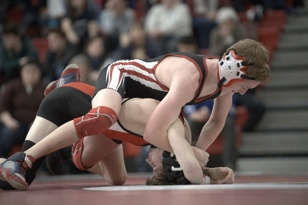 Camden Hills' Eric Andrews, top, tries to pin Cony's Noah Dumas during a 106-pound match at the Class A North championship Saturday at Camden Hills.