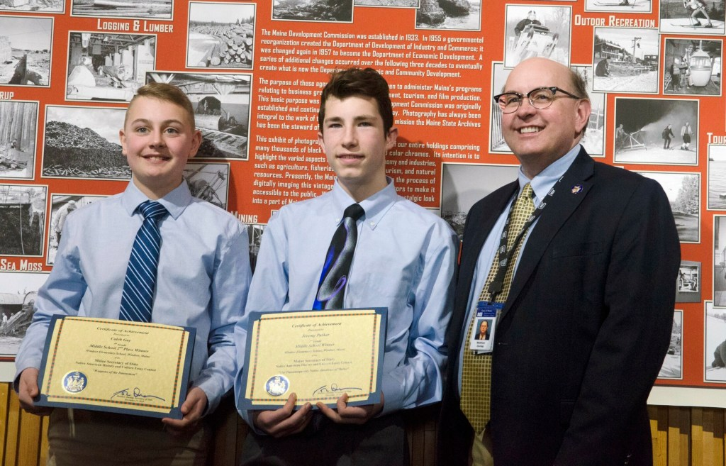 Windsor Elementary students and essay contest winners Caleb Gay, left, and Jeremy Parker pose for a photo with Maine Secretary of State Matt Dunlap on Thursday at the Maine Archives in Augusta.