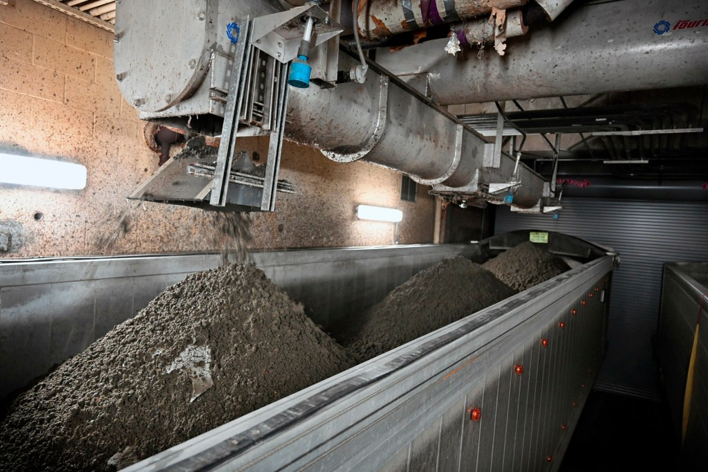 Sludge is dumped into a truck at the wastewater treatment plant in Portland in April.