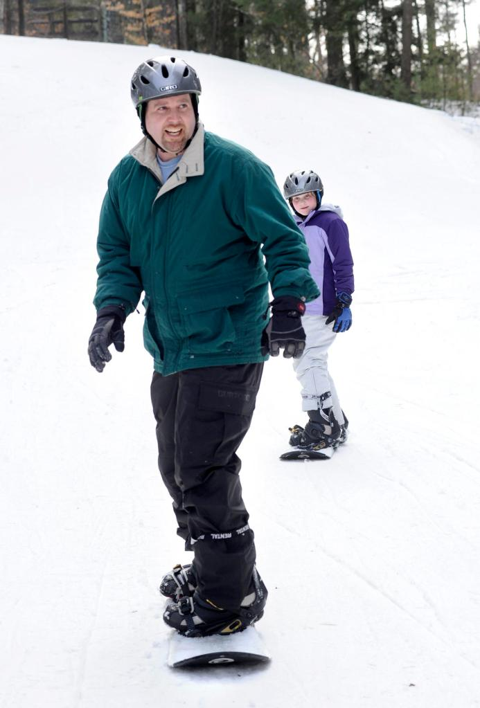 """Drew Sachs and daughter Deidre try boarding. Sachs says he and his wife, Melanie, """"both turned 40 this year and we said, 'This is the year we try new things.' """""""