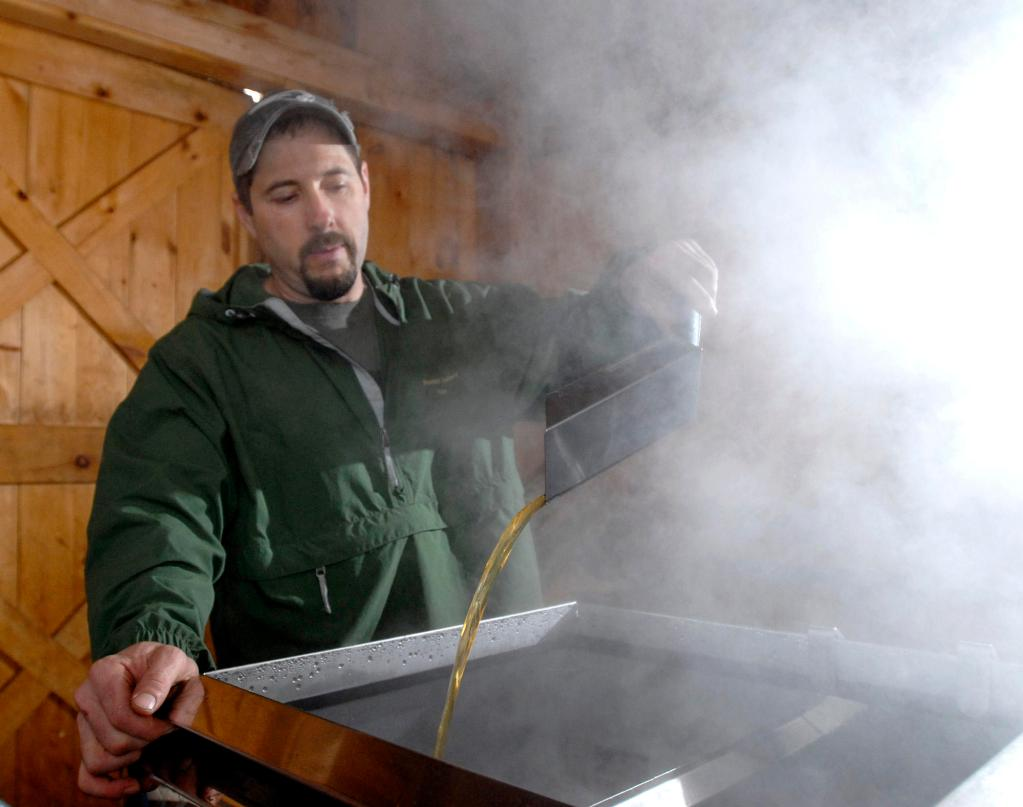 Keith Harris of Harris Farm in Dayton monitors sap boiling into maple syrup Tuesday. He has already produced about 10 percent of what he expects to make this season at a time when the taps on his 525 maple trees are usually still dry. There is concern the sap run will be over before Maine Maple Sunday on March 28.