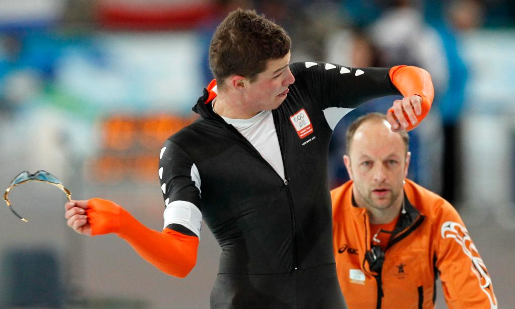 Sven Kramer of the Netherlands tosses his glasses away Tuesday after being disqualified for forgetting to switch a lane.