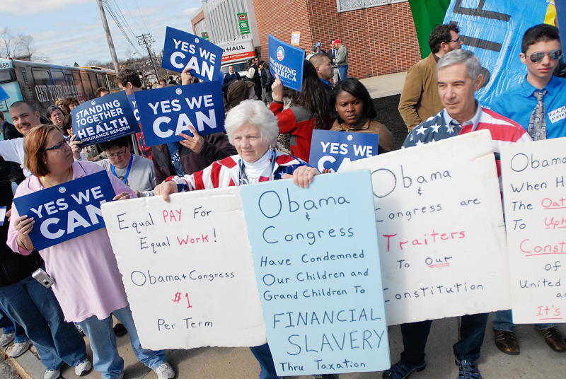 Anti-Obama protesters Pat and Frank Giordano of Newport stand in front of Obama supporters outside the Expo today.