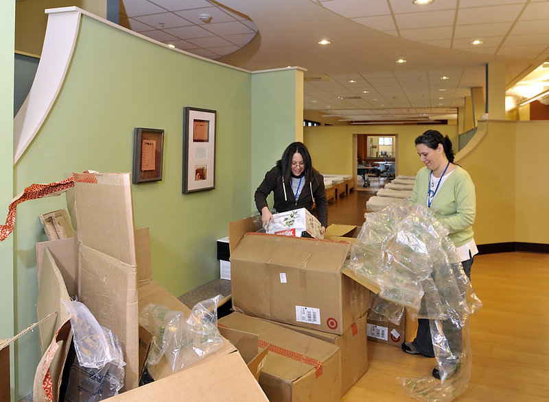 Frances Mercado, left, and Tracy Kane unpack supplies for Florence House on Valley Street, the new home for homeless women.