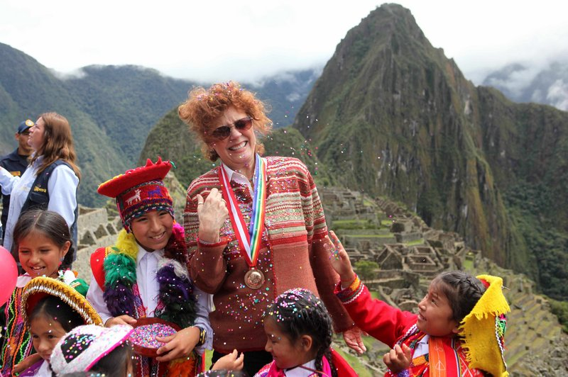 Actress Susan Sarandon reacts Thursday as a a girl tosses confetti during the reopening of the citadel of Machu Picchu. Peruvian officials celebrated the reopening of the Inca citadel after a two-month closure due to flooding.