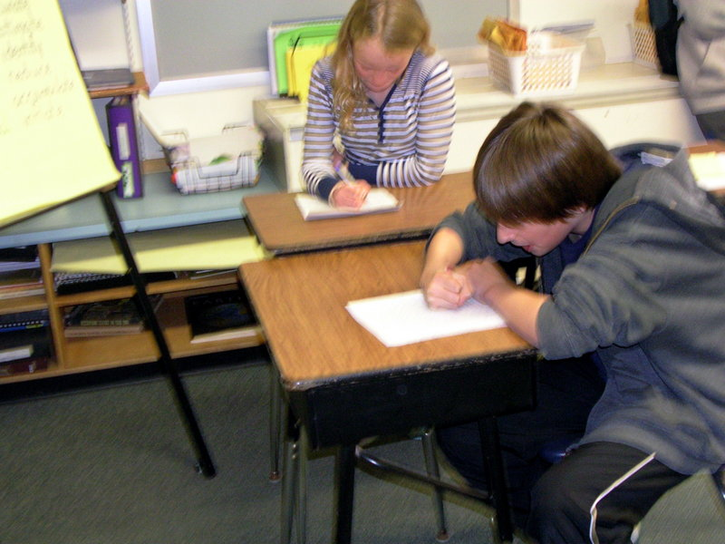 North Yarmouth Memorial School fifth-grader Maxwell Burns writes to author Rick Riordan, while his classmate writes to actor Mike Myers.The students are hoping celebrities will respond to their requests for money to ship books to the Chikumbuso Project in Lusaka, Zambia.