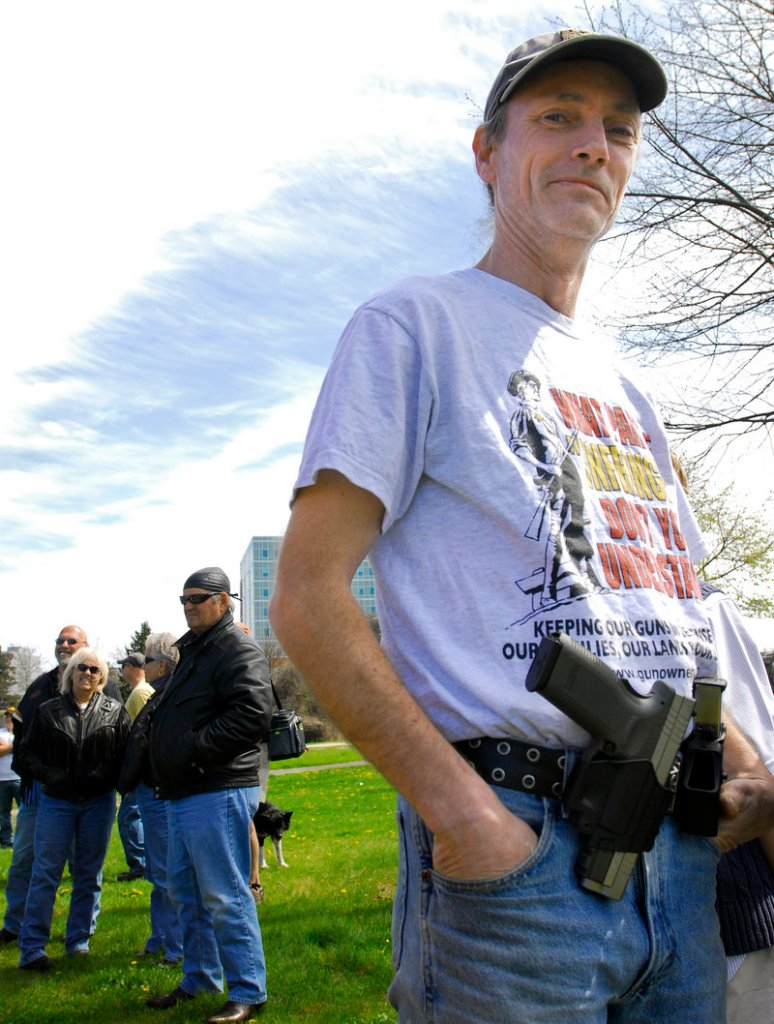 Cory Mills of Biddeford displays his Springfield Armory XD45 at the Back Cove event.