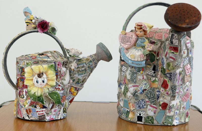 Watering cans, here as decorated by artist Bonnie Arkin, are among the many garden pieces that can be covered with a mosaic. do-it-yourself do it yourself 10000000 2010 10004000 krtnational national krtedonly LEI 10004003 krtfeatures features krt2010 krtgarden garden gardening leisure LIF FEA mct krthobby hobby krtlifestyle lifestyle 10004001