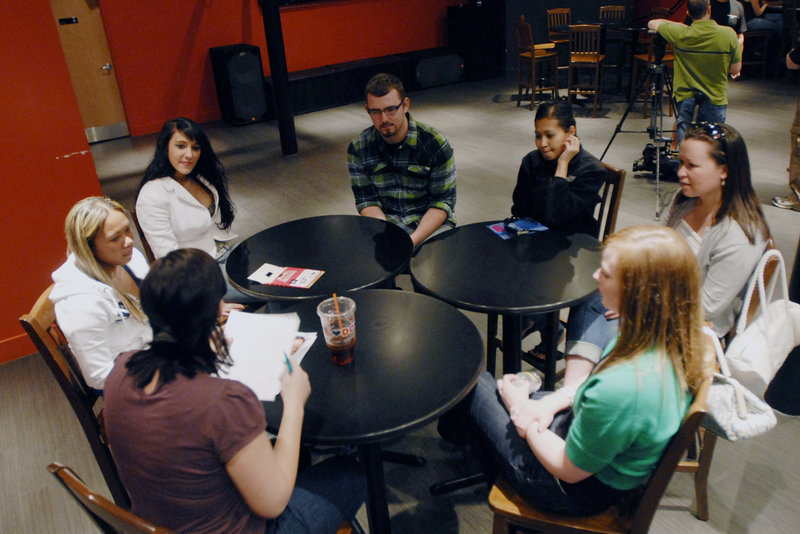 """Jessica Thompson, lower left, a casting director for """"The Real World,"""" interviews a group of applicants in Portland. Those who make the cut will participate in more in-depth interviews today."""