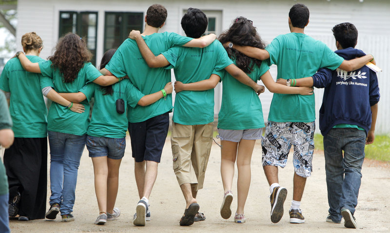 Campers leave the opening ceremony for the Seeds of Peace camp in Otisfield on Thursday. For three weeks, more than 150 youths from Israel, the Palestinian Territories, Egypt, Jordan, Afghanistan, Pakistan, India and the United States will learn from each other.