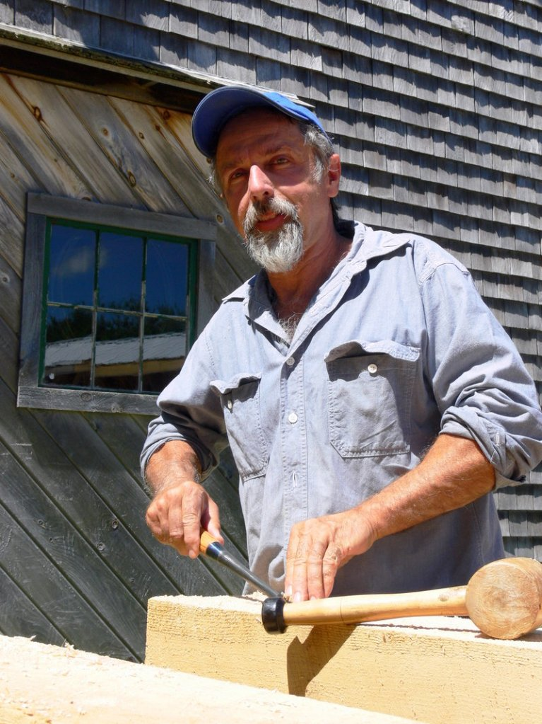 Andy Buck, a timber framer and friend of Bob Dunning, works on the memorial bridge to Pondicherry Park.
