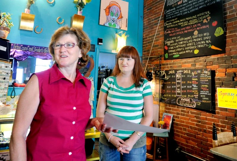 """Linda Converse, left, and her daughter Ellen own and operate Oh Baby Cafe on Main Street in Biddeford. Restaurateurs in the region are finding breakfast to be """"recession-proof."""""""
