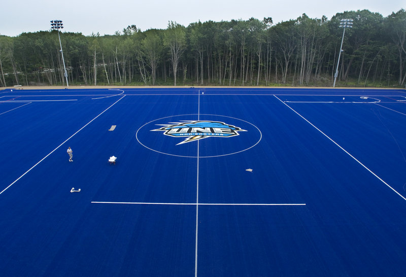 The Nor'easter logo is among the last finishing touches being added last week to the University of New England's new turf field, a recent addition that will be used principally by the school's lacrosse and field hockey teams.