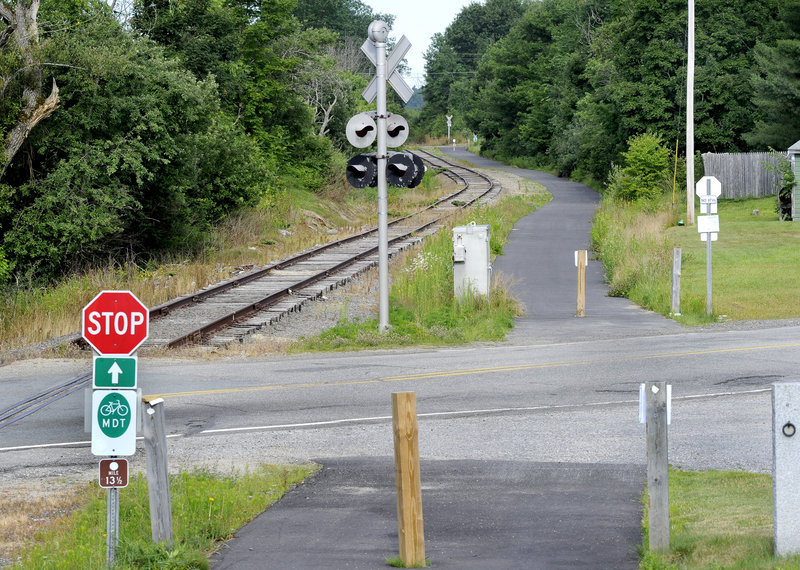 The Mountain Division Trail, seen here looking north crossing Route 237 in Gorham, starts in Standish.