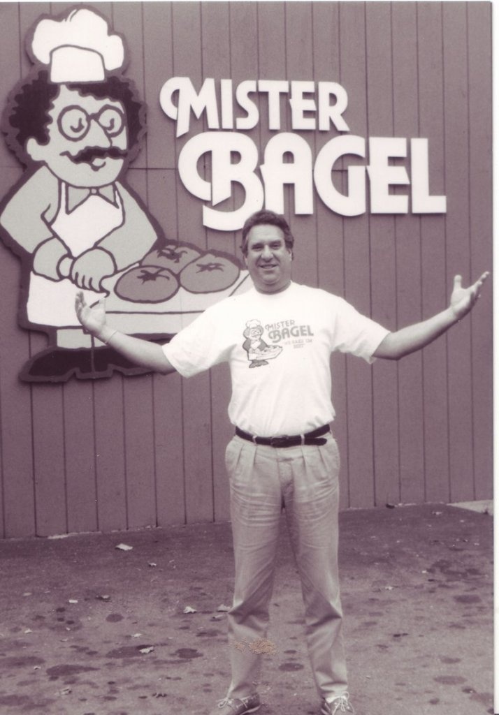 """Eric """"Rick"""" Hartglass created Mister Bagel's trademark sign, a caricature of himself that now graces the signs of 12 franchises in Maine."""