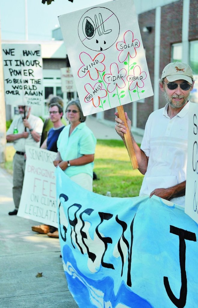 Dan Rynberg of Yarmouth protests Senate inaction on climate change Wednesday outside the Muskie Federal Building in Augusta.