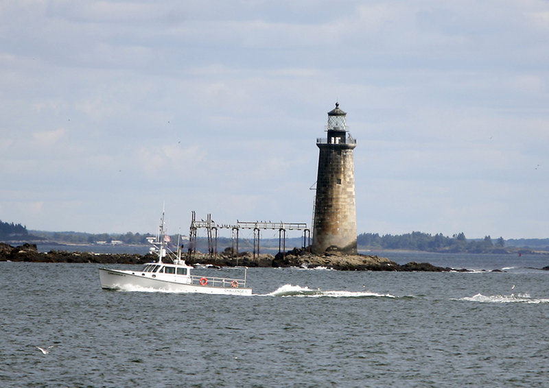 Ram Island Ledge Light is seen Tuesday from a tour boat in Casco Bay. Now that it is in private hands, it will be placed on the tax rolls. But it's unclear whether it is in Cape Elizabeth, as the federal government thinks, or Portland, as locals believe.