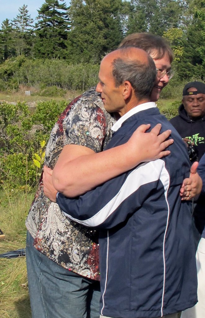 Gov. John Baldacci embraces Marilyn (Darling) Voter of South Portland after apologizing to descendants of Malaga Island residents.