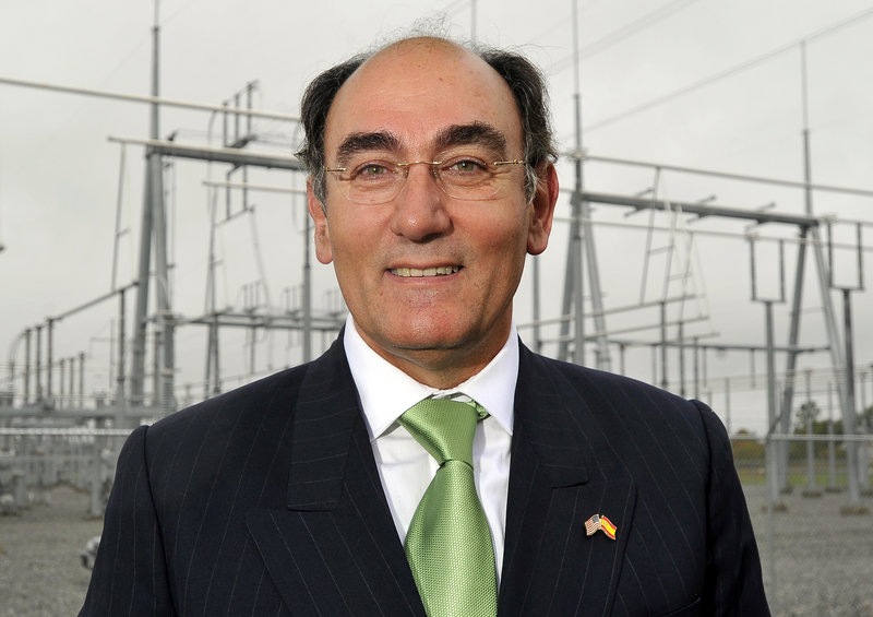 Ignacio Galan, chairman of the Iberdrola Group, toured the new CMP substation in Gorham, in background, as he marked the start of the $1.4 billion Maine Power Reliability Project on Tuesday.