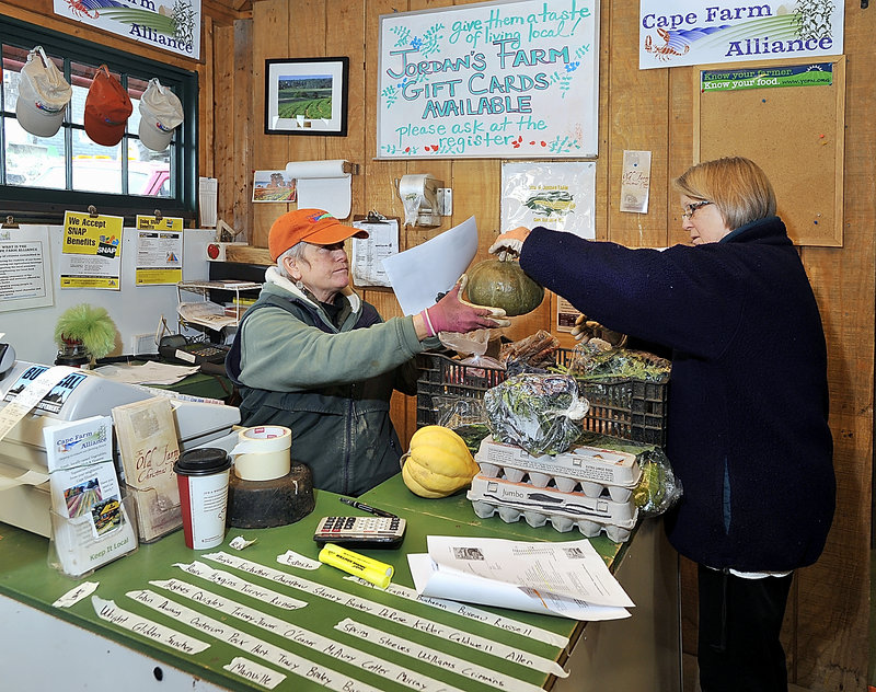 Penny Jordan and her sister, Pam Butterfield, make sure online orders are filled and charged to customers correctly at Jordan Farm in Cape Elizabeth. More information is available on the Cape SoPo Winter Share Facebook page.