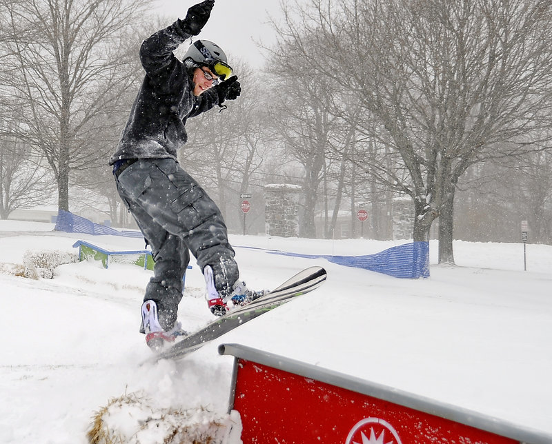 Brent Legere jumps onto a rail at Payson Park's terrain park. The park has grown rapidly in the past two years, thanks to donated terrain park features and snow guns. The park will have free skiing and riding lessons available on Wednesday afternoons starting Jan. 5.
