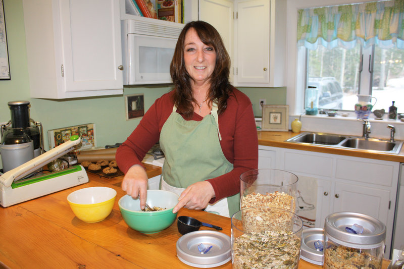 Betty Crush creates her raw, vegan energy bars in her Freeport kitchen. Mom's products are free of gluten and refined sugars.