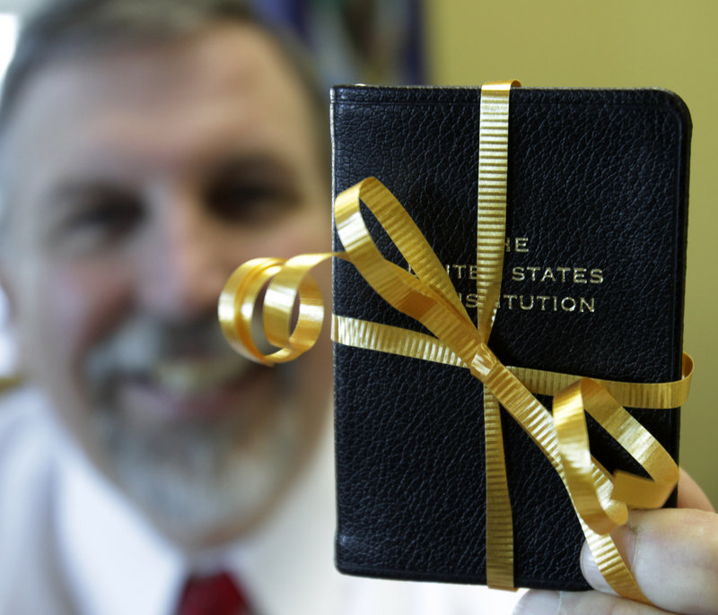 Former Army Ranger William J. Schneider packs a U.S. Constitution as he sets out on his latest mission, as Maine attorney general.