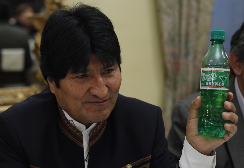 President Evo Morales holds a bottle of Coca Brynco, a Bolivian soda made with coca leaves, during a meeting with foreign reporters last week in La Paz.