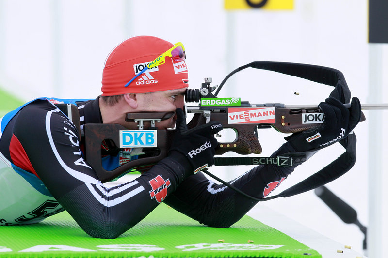 Arnd Peiffer of Germany takes aim from the prone position on his way to winning the men's 10-kilometer sprint at the World Cup biathlon competition Friday at Presque Isle.
