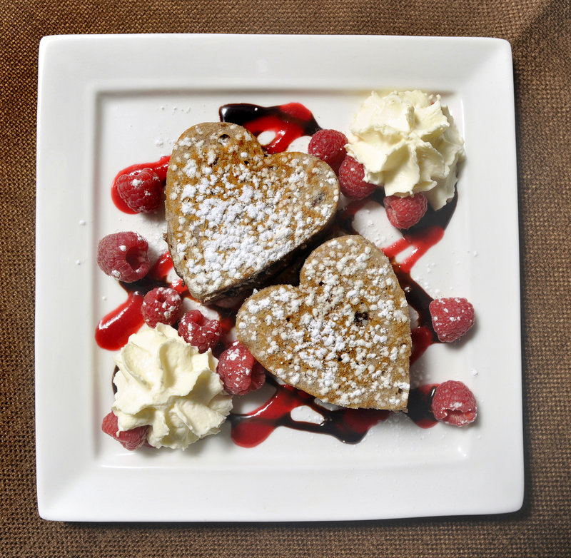 Dana Moos' Chocolate Ricotta Pancakes with chocolate sauce, raspberry coulis and whipped cream.