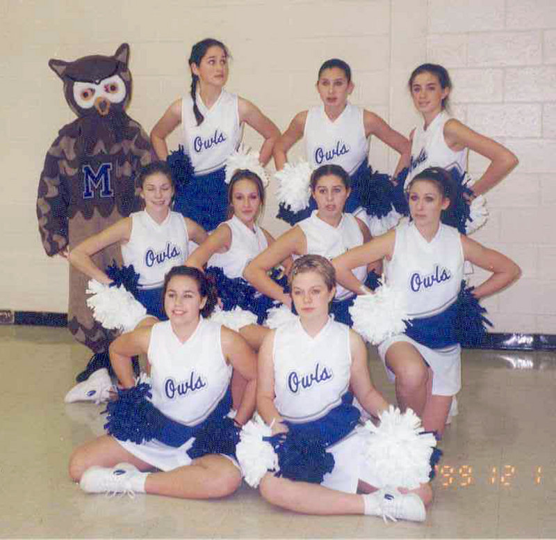 This cheerleading squad photo was taken in December 1999 and shows, from left, front row: Ashley Daigle and Lori Ann Michaud Richardson; center row: Lynel Winters, Ashley Hebert, Bonnie Cyr Lyford and Jessica Bellefleur; back row: the school mascot, Sylvie Nadeau, Alison Levesque Danielson and Amy Chasse Desjardins.